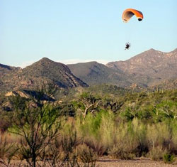 Low flying motorized parachute